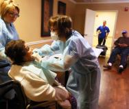 """The lack of daily oral care in nursing facilities is """"an epidemic that's almost universally overlooked,"""" said Dr. Sarah Dirks, right, a dentist who treats nursing home residents in San Antonio."""
