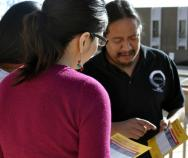 "Sonny Weahkee, a health guide working to sign Native Americans up for health insurance, demonstrates his outreach ""rap"" with coworkers outside the nonprofit's headquarters in Albuquerque."