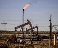 An oil field operation flares natural gas in the area of Loco Hills, between Artesia and Hobbs, in this Journal file photo. Gov. Michelle Lujan Grisham's administration is opposing federal regulations that would remove certain methane emission limits. (Roberto E. Rosales / Journal)