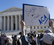 A demonstrator holds a sign in support of the Affordable Care Act in front of the U.S. Supreme Court last November. On Thursday, the justices did just that. | Alex Brandon | AP