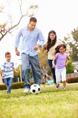 stock-photo-48090908-hispanic-family-playing-soccer-together.jpg