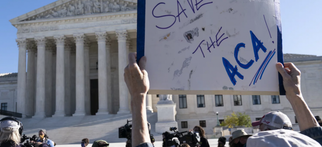A demonstrator holds a sign in support of the Affordable Care Act in front of the U.S. Supreme Court last November. On Thursday, the justices did just that.   Alex Brandon   AP
